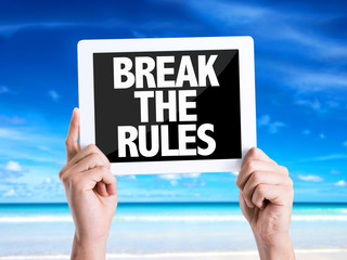 Tablet pc with text Break the Rules with beach background
