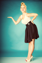 Pin up woman with hand gesture.