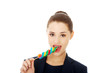 Young businesswoman licking a lolipop