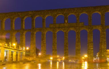 old Roman Aqueduct in night. Segovia