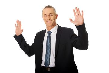 Businessman pressing an abstract touchscreen