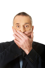 Portrait of businessman covering mouth