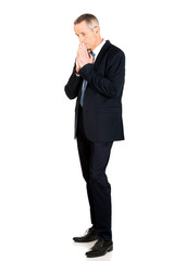 Full length businessman with clenched hands