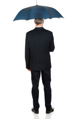 Full length back view businessman with umbrella