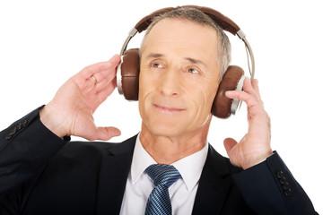 Businessman with big headphones