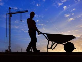 The worker with a wheelbarrow