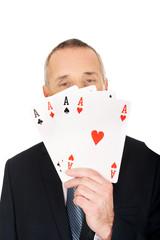 Elegant man with four aces