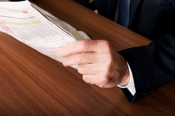 Businessman hand with newspaper