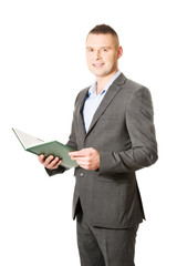Young businessman reading his note book