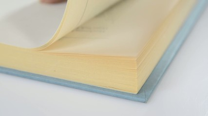 Closeup of the pages of a book being flipped