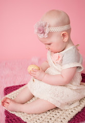 Baby holding an Easter Egg