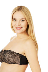 Smiling pregnant woman in lingerie
