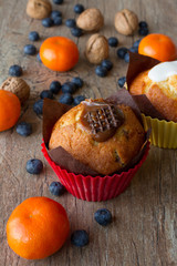 chocolate and vanilla Lemon muffins with tangerines and walnuts