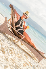 young beautiful woman enjoying summer vacation, beach relax, sum