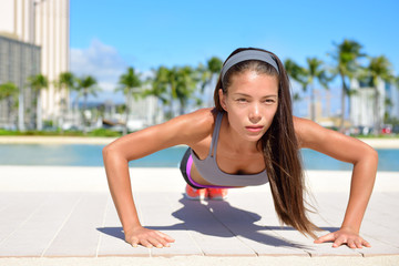 Push-ups fitness sport woman doing pushups outside