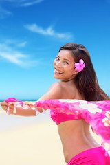 Happy free bikini woman on Hawaiian beach vacation