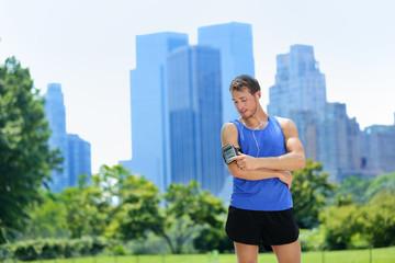 New York City runner listening music on smartphone