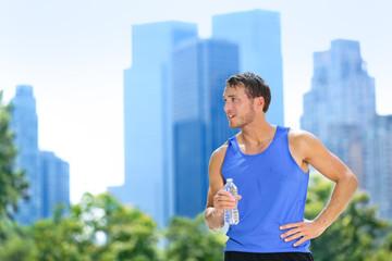 Sport man drinking water bottle in New York City