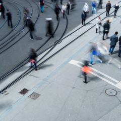 urban traffic concept - city street with a motion blurred crowd