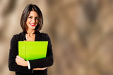 smiling professional woman on brown background
