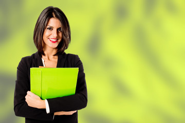 smiling professional woman on green background