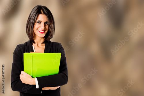 smiling professional woman on brown background - 79476749