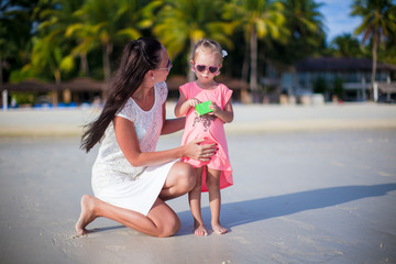 Mother and adorable girl during beach vacation