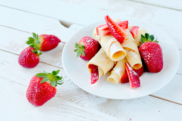 Pancakes with fresh strawberry fruits and castor sugar