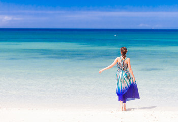 young happy woman on tropical sand beach