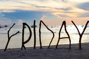 Perfect white sandy beach on tropical island with wooden letters