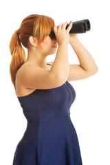 Fat woman looking through binoculars