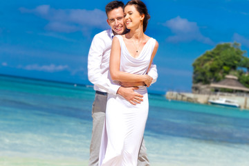young loving couple on their wedding day, outdoor beach wedding