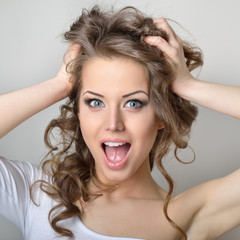 Surprised beautiful girl. Attractive young emotional woman.