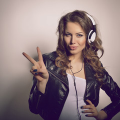 Young beautiful woman with headphones listening music. Teenager