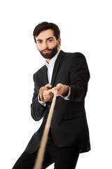 Businessman pulling a rope.