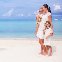 Mother and adorable girls during beach vacation