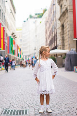 Little adorable girl walking in Milan on italian vacation