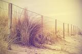 Vintage retro filtered beach dune, nature background.