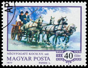 Stamp printed in the Hungary shows four-in-hand