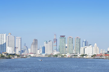 Business district cityscape with blue sky, Bangkok