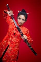 Asian woman holding sword