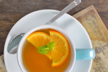 cup of tea and orange slices