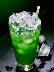 Green cocktail  on dark background.
