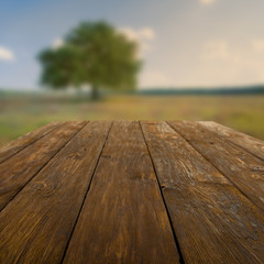 Wooden table outdoors with autumn field background