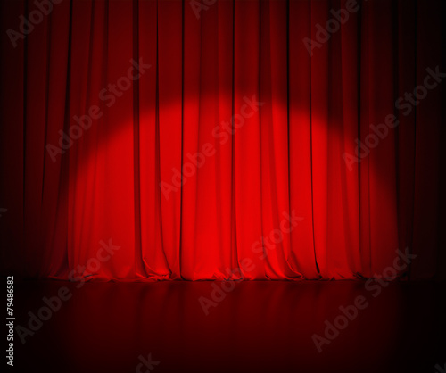 theatre red curtain or drapes background with light spot - 79486582