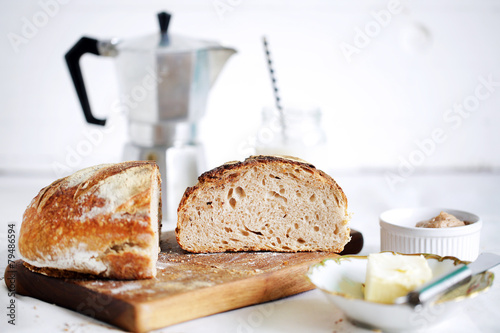 Breakfast table with rustic sourdough bread, butter and coffee - 79486594