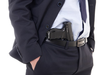 close up of gun in policeman or bodyguard pants isolated on whit