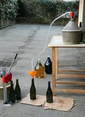homemade bottling red wine in glass bottles