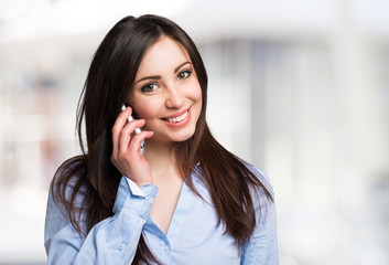 Smiling young woman talking on the mobile phone