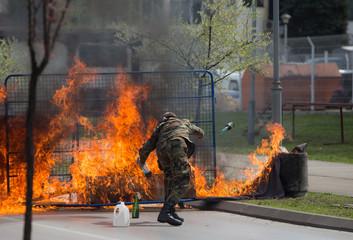Man uniform  Molotov coctail